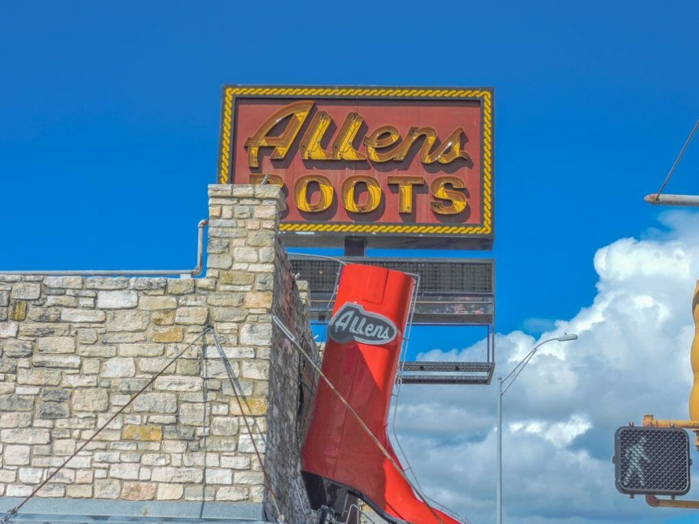 Allens Boots red sign with blue skies South Congress Austin