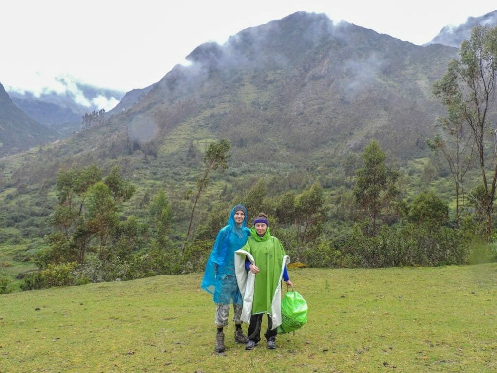 Couple ponchos Peru hike