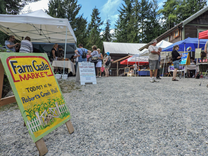 Farm Gate Market stalls and people in Roberts Creek_