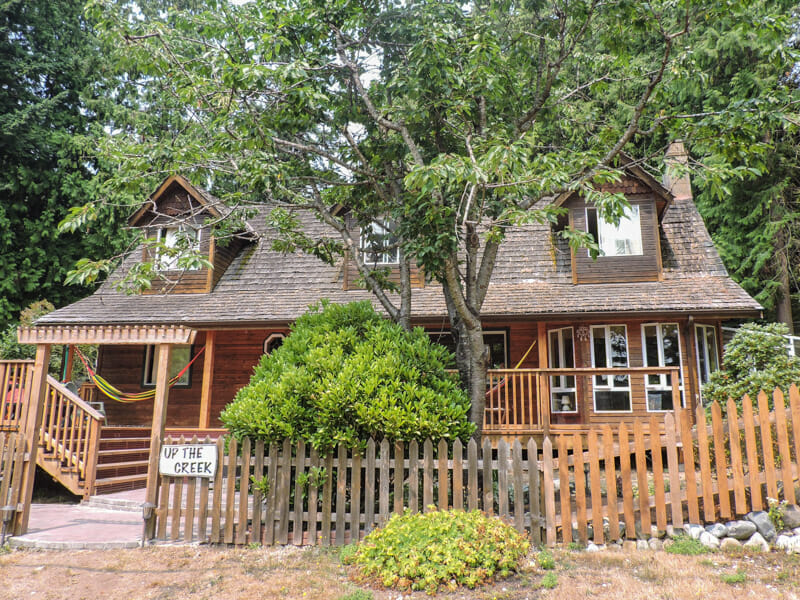 Large wooden house with trees. Up the Creek Roberts Creek