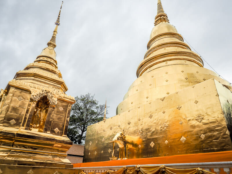 Wat Phra Singh gold temples with grey clouds