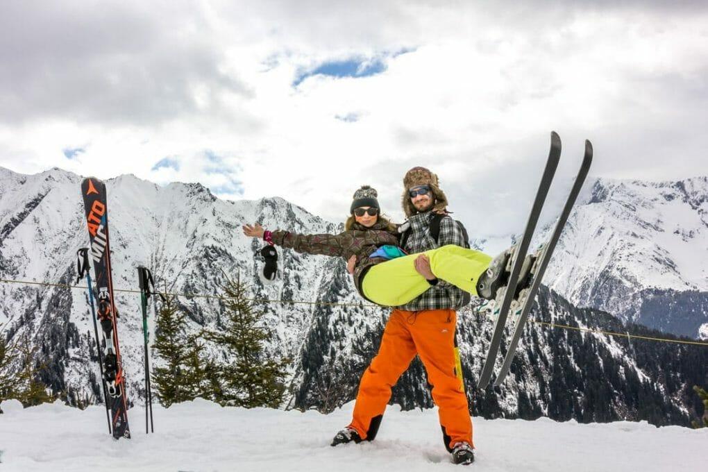 Couple with skis on mountain
