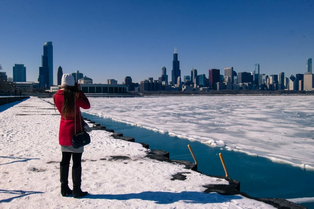 Chicago panoramic view in the winter. Woman in red coat.