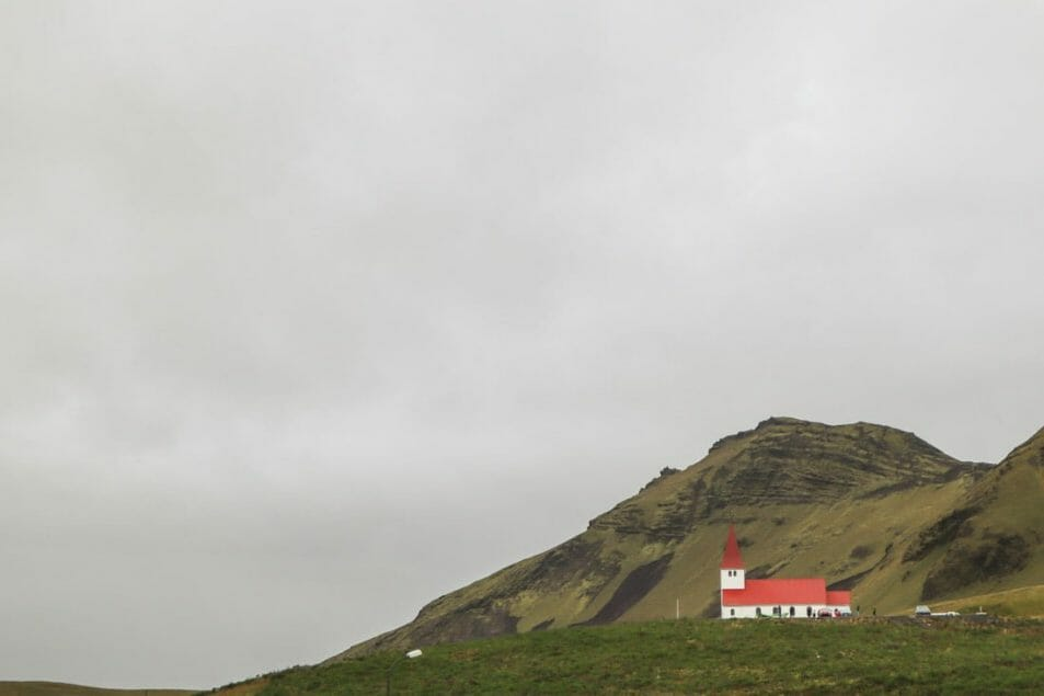 Vik, church red roof, green hills, Iceland