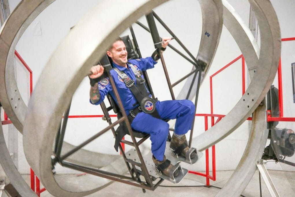 Man in space suit on NASA simulator