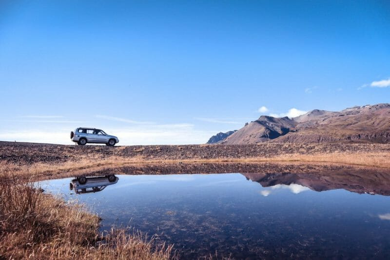 Car Iceland landscape water