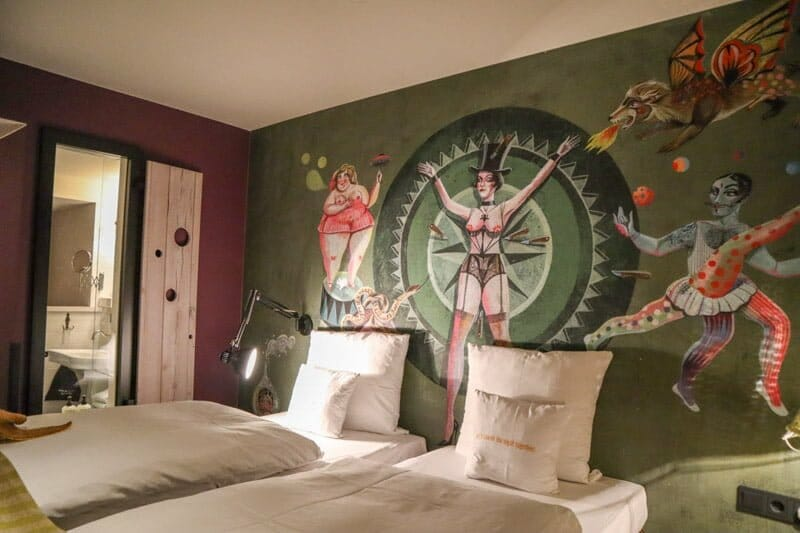 25Hours Hotel Vienna room, circus print, bed