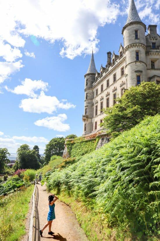 Dunrobin Castle Gemma Holding Hat North Coast 500 Scotland_