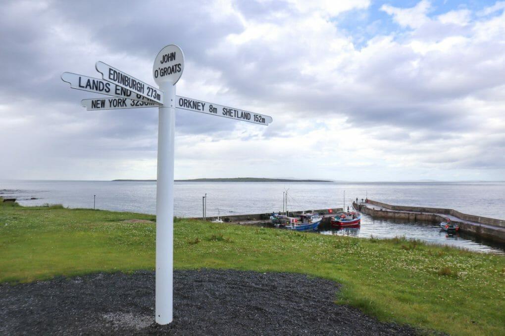 John o Groats signpost bright North Coast 500 Scotland_