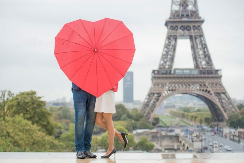 Red heart umbrella, couple kissing, romantic Eiffel Tower