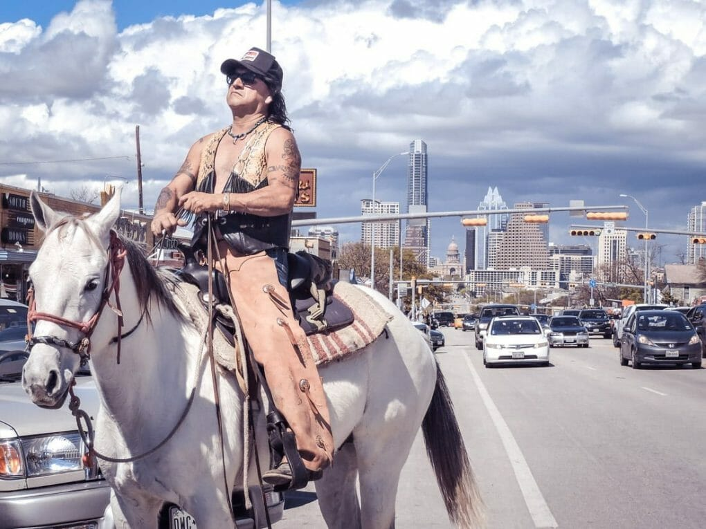 Man on horse South Congress buildings
