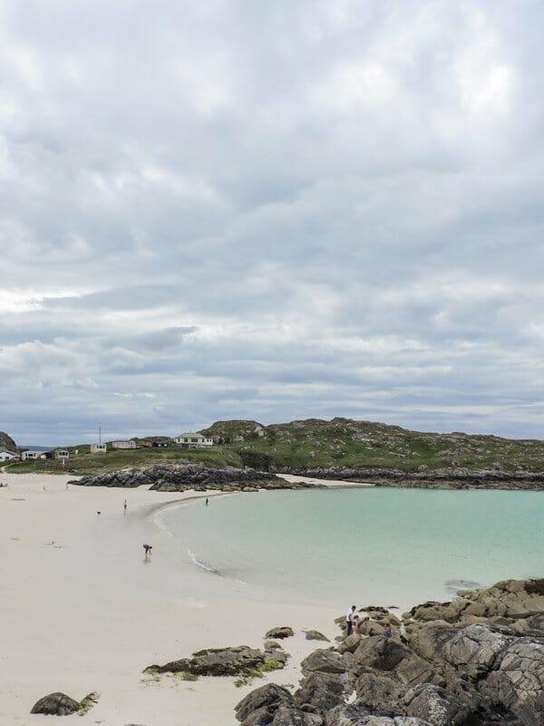 Achmelvich beach, sea, white sand, rocks, people North Coast 500 Scotland