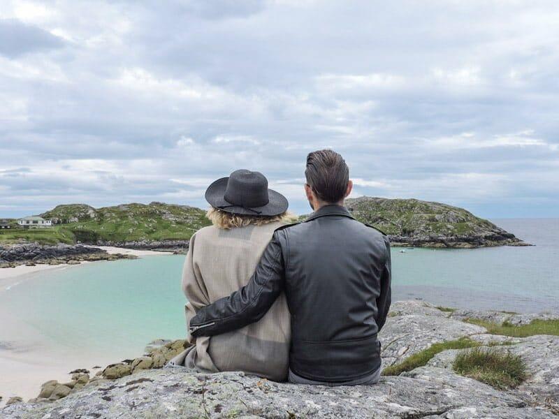 Gemma, Craig sitting on rock, Achmelvich Beach Scotland North Coast 500_