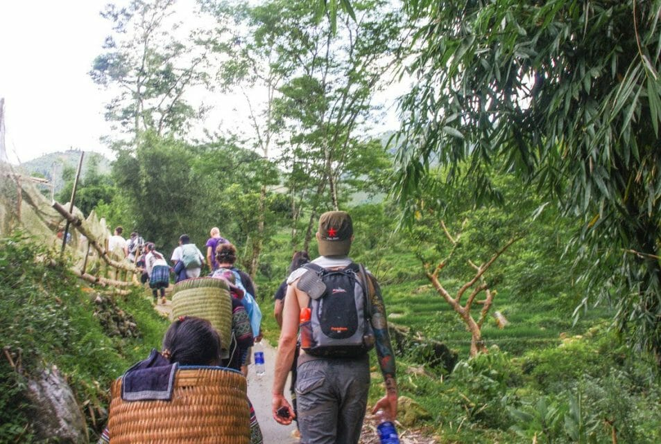 Hiking Sapa Valley in Vietnam, Craig, day bag, flip flops, bug spray, water bottle, native woman.