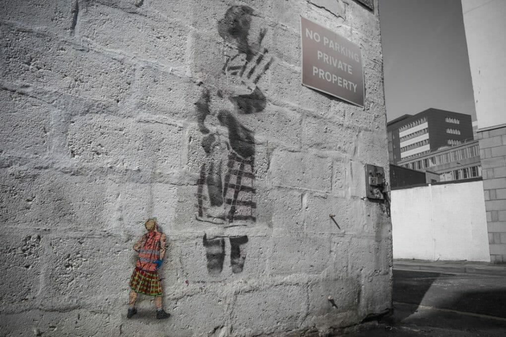 Jaune mural of small sanitation worker next to piper stencil Nuart Aberdeen_