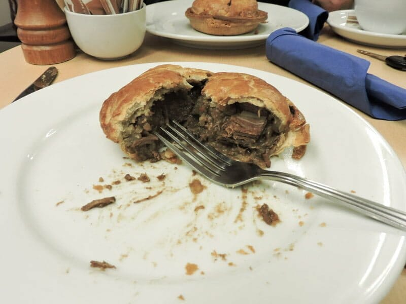 Lochinver steak pie, plate, cutlery, table