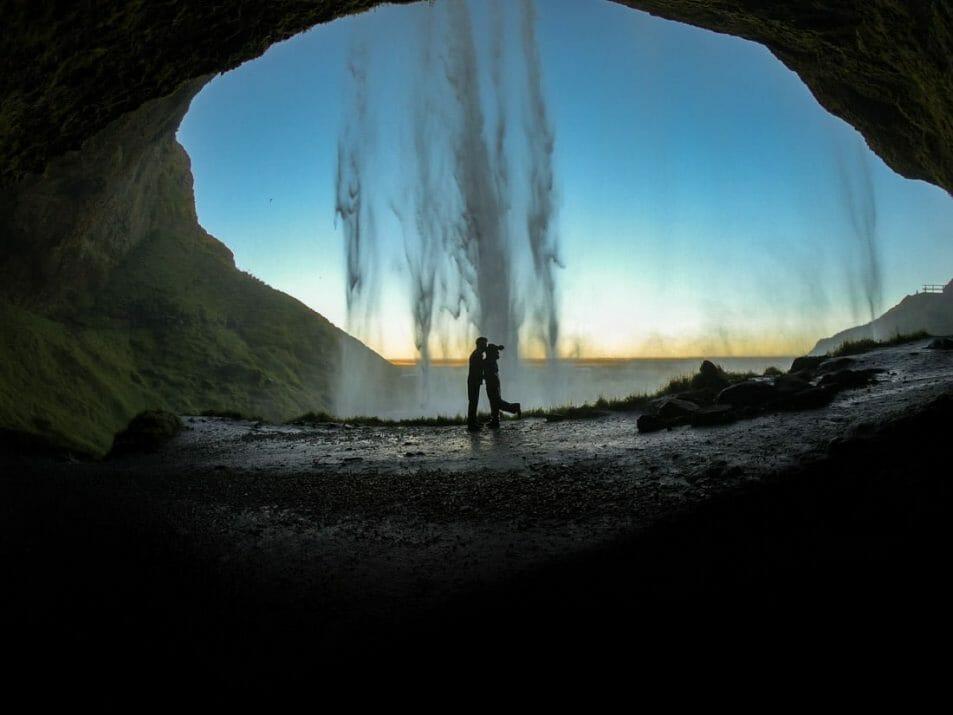 Seljalandsfoss Iceland Waterfall Hike. Gemma and Craig kiss at sunrise.
