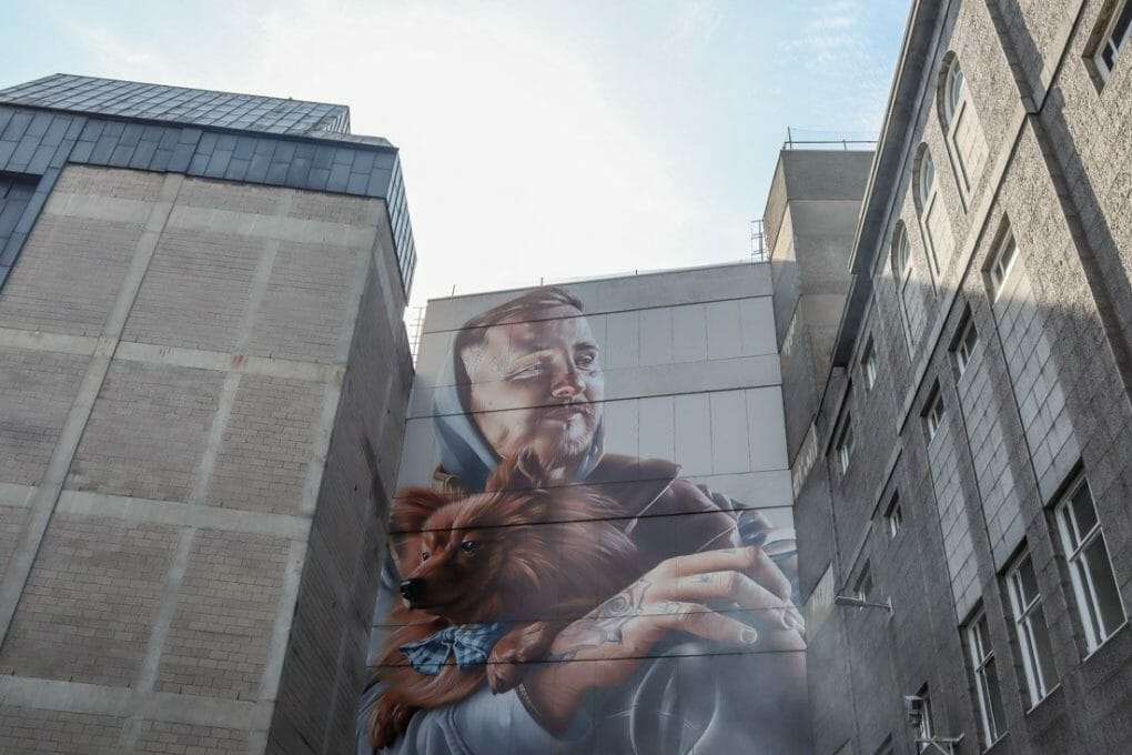 Smug Nuart man with dog mural