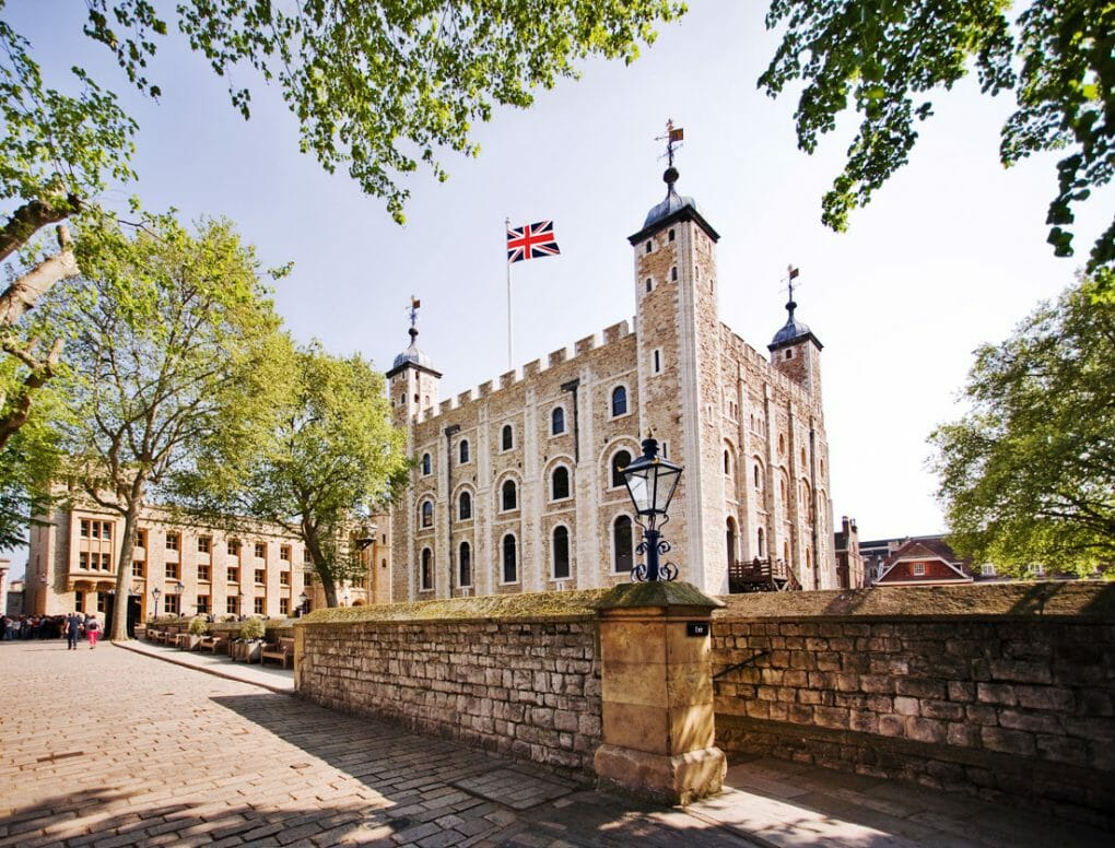 Tower of London guide. flags, blue skies