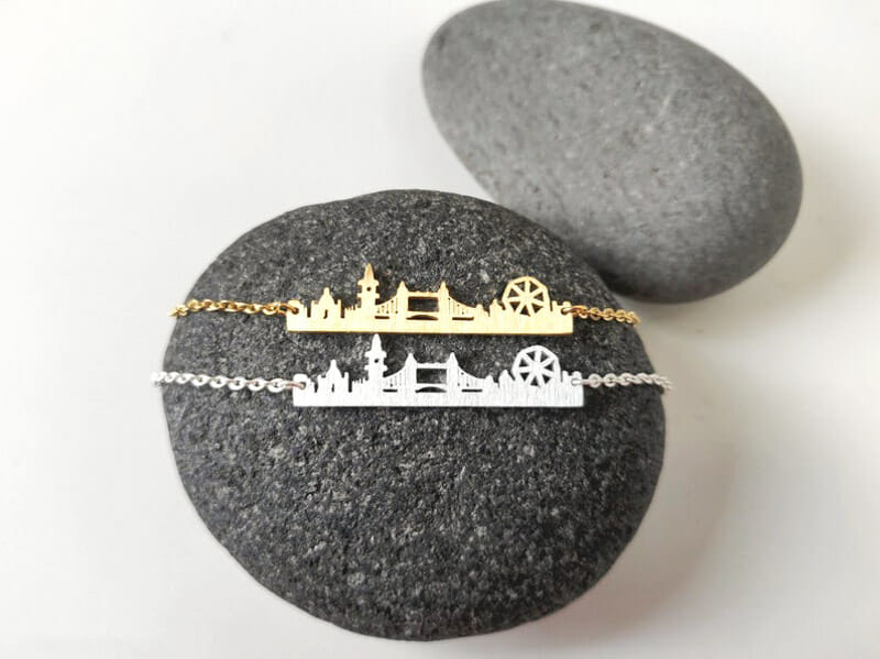 London skyline necklace gold and silver on grey rock