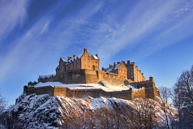 Edinburgh Castle with snow and blue skies _