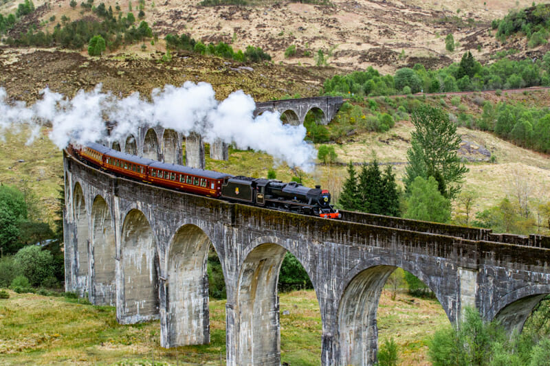 Harry Potter steamtrain going over Glenfinnan Viaduct