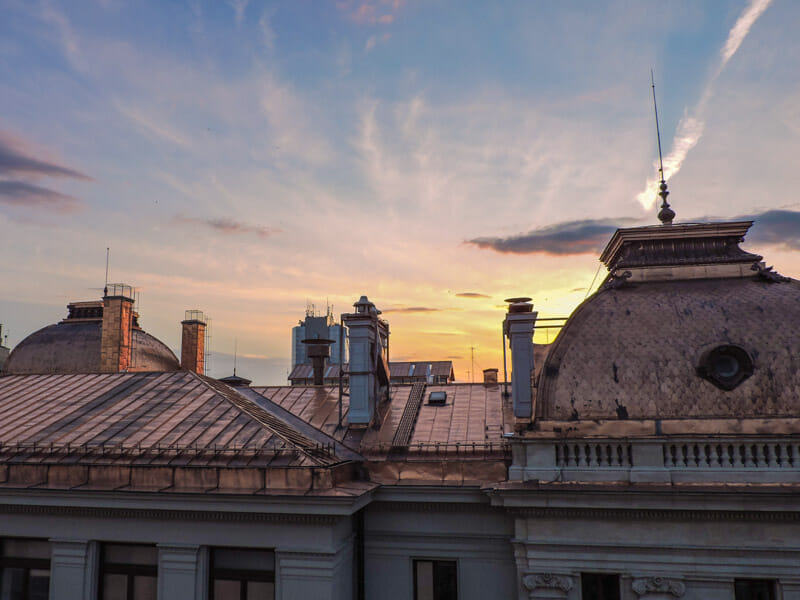Sunset over buildings in Bucharest Old Town