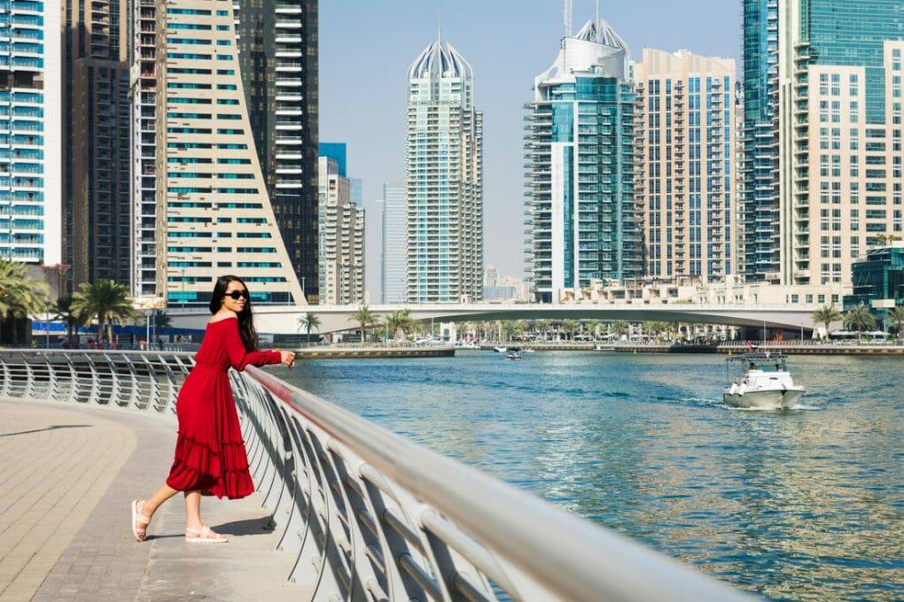 Girl in red dress with Dubai skyline