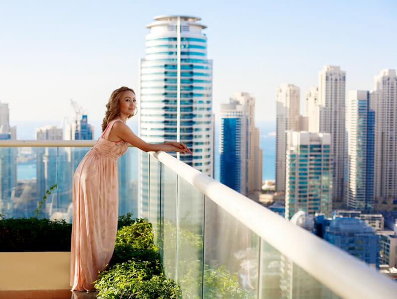 Women wearing long dress with Dubai skyline