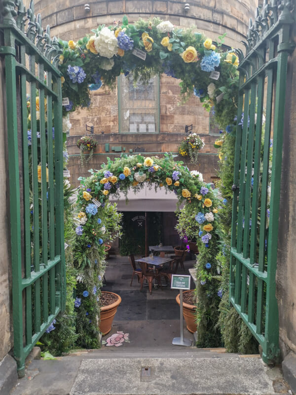 Rose Street Garden entrance with flowers_