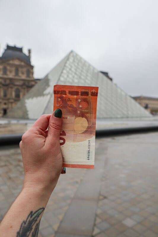 Euro in front of Louvre Paris