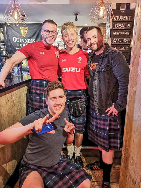 Rugby fans in kilts Edinburgh