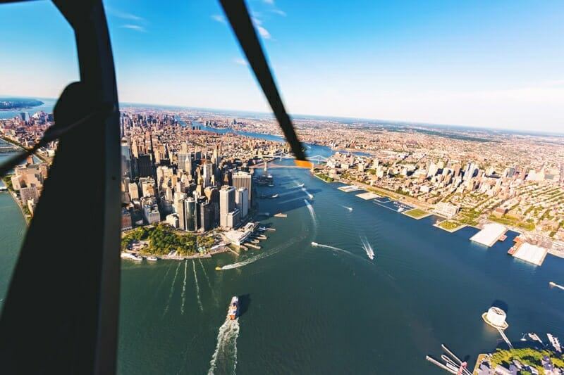 Helicopter aerial view of lower Manhattan New York City and the Hudson River NYC