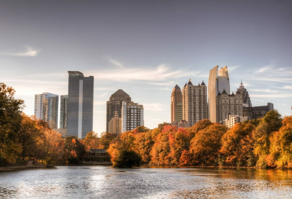 Skyline and reflections of midtown Atlanta, Georgia in Lake Meer from Piedmont Park