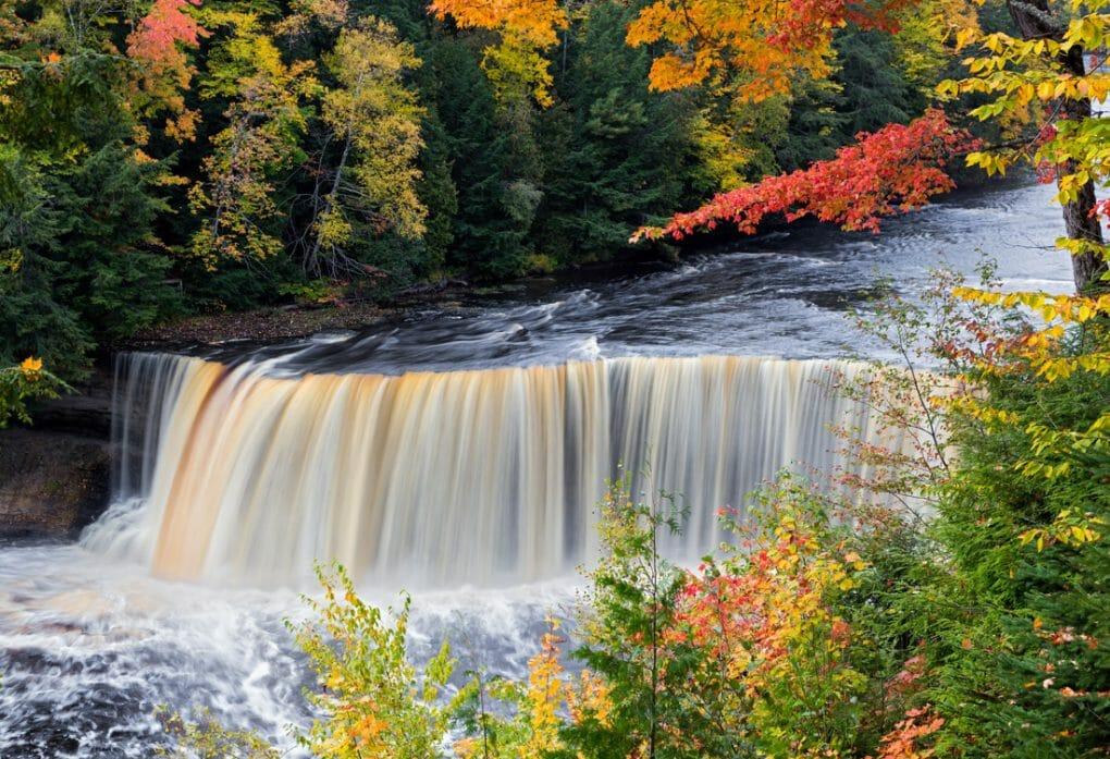 Michigan Tahquamenon falls with fall leaves on trees