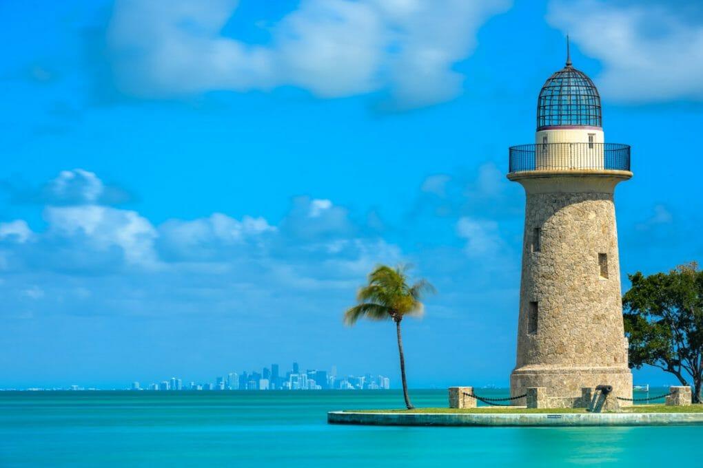 Boca Chita Lighthouse and Miami Skyline on calm day
