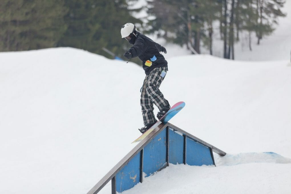 A snowboarder on a ramp at the Wisp Ski Resort in Deep Creek Lake Maryland.