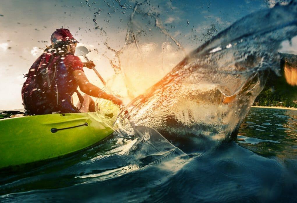 Kayaker in water at sunset
