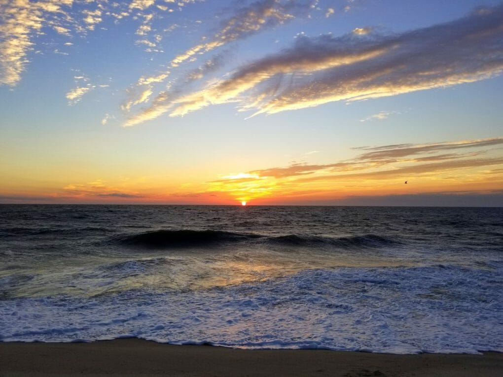 Beautiful sunrise and waves in the early morning near Dewey Beach, Delaware, U.S.A Depositphotos_436221082_l-2015