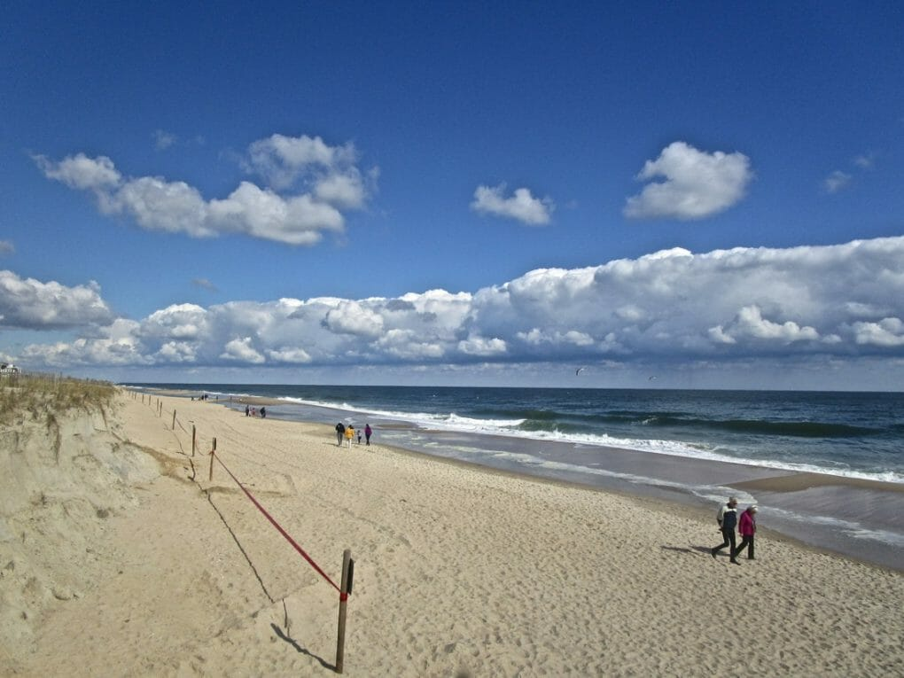 Bethany Beach, Delaware, USA. A long, low band of beautiful white clouds along the beach on the Atlantic Ocean. Depositphotos_390835494_l-2015